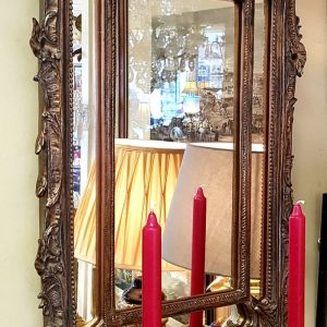 Rococo style gilt pier mirror with candelabra